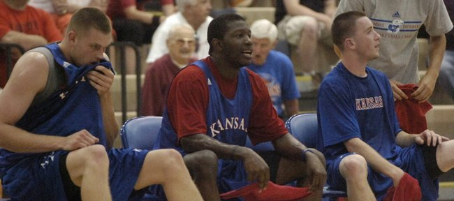 KU junior Mario Little, center, takes a breather with his Blue team teammates Cole Aldrich (left) and Brady Morningstar.