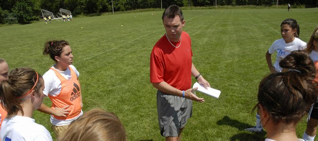 Lewis Theobald, head coach of the women's soccer team at the University of Central Missouri, speaks to campers at a soccer showcase on Tuesday at Free State High.