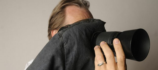 A blimp bag covering a photographer's camera is used as a quieting device for courtroom photography. Although photography in courtrooms is allowed by news organizations, it is not without restrictions.
