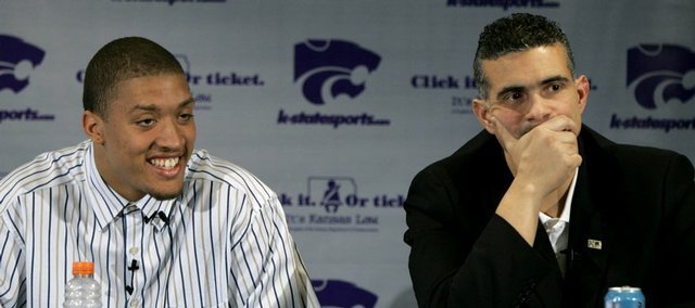 Kansas State freshman Michael Beasley, left, and coach Frank Martin listen to questions at a news conference. Beasley announced his decision to enter the NBA Draft in April.