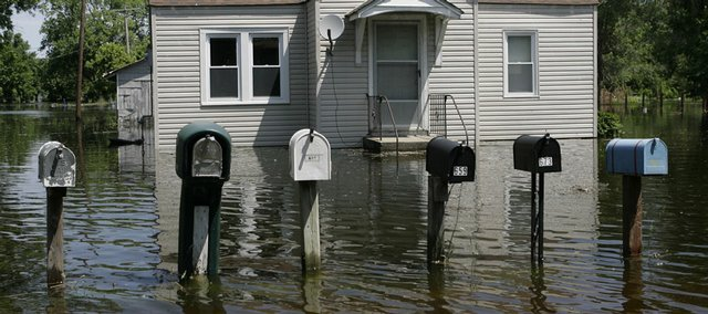 Floodwaters from the Mississippi River surround mailboxes and a house on Saturday in Foley, Mo. At Foley, more than half of the homes in the town of 200 residents were under water.