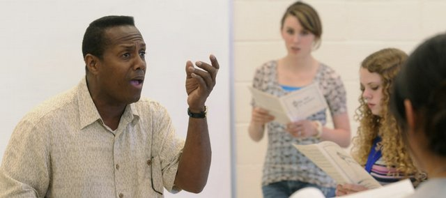Paul Tucker, Kansas University's new choir director, conducts rehearsal for a choir camp Wednesday at Murphy Hall. The Jamaican native was a budding concert pianist and later became a commercial pilot before returning to his passion: music.