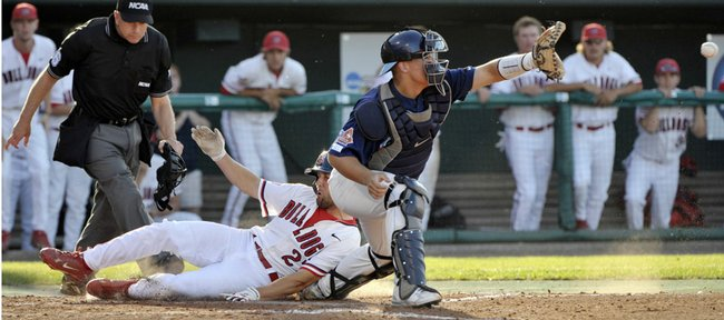 Fresno State's Steve Susdorf scores on a base hit by Tommy Mendonca, as North Carolina catcher Tim Federowicz, right, waits for the ball. Fresno State ousted UNC from the College World Series, 6-1, Sunday in Omaha, Neb.