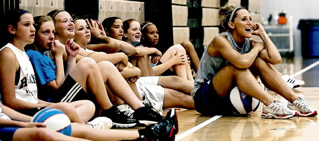 Kansas women's basketball senior Katie Smith, right, sits with campers as they watch the finals of a game of knockout. The action was part of Bonnie Henrickson's basketball camp Monday at Horejsi Center.