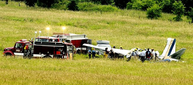 Federal Aviation Administration personal and Kansas Highway Patrol Troopers work the scene of a plane crash about 6 p.m. Tuesday near the intersection of Leavenworth County Road 1 and Cantrell Road south of Tonganoxie. Two people were killed in the crash, which occurred about 10:30 a.m. Tuesday.