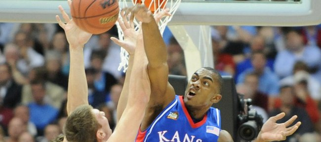 Kansas forward Darrell Arthur rejects a shot by North Carolina forward Tyler Hansbrough in the first half of the Jayhawks' Final Four victory over the Tar Heels in April at the Alamodome in San Antonio.
