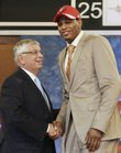 Brandon Rush, right, is congratulated by NBA Commissioner David Stern on Thursday in New York. Portland selected Rush No. 13 overall, then traded the former Kansas University guard/forward to Indiana, where he will join his brother, Kareem.