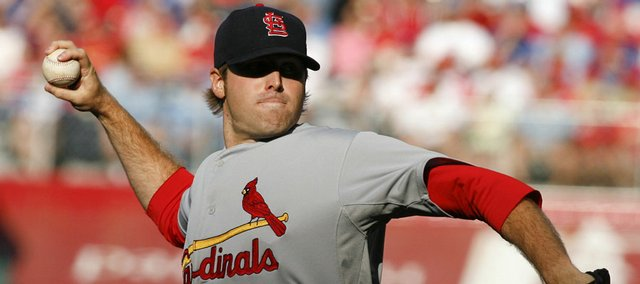 St. Louis Cardinals starting pitcher Mitchell Boggs delivers during the first inning of the Cardinals' 5-1 victory. St. Louis snapped the Royals' six-game winning streak Saturday in Kansas City, Mo.