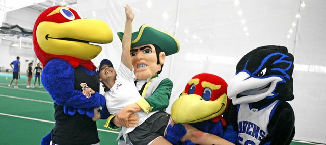 Various mascots carry off Emily Ellison during a performance practice Saturday at the KU Spirit Camp at Anschutz Sports Pavilion.