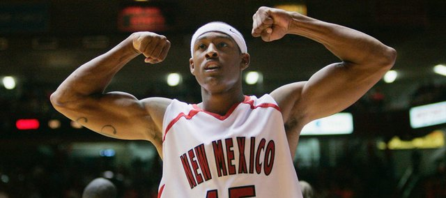 New Mexico's J.R. Giddens flexes for the crowd near the end of the second half of a college basketball game against Kansas State in this Nov. 21, 2006, file photo.