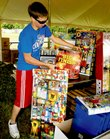 Ryan Hutton helps set up a fireworks stand Monday south of Lawrence on U.S. Highway 59. Many area fireworks vendors have high expectations for Independence Day sales. This year's holiday falls on a Friday, and rain is not in the current forecast.