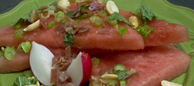 Watermelon shares the plate with prosciutto in this Watermelon Salad with Mint and Crispy Prosciutto from Real Simple magazine.
