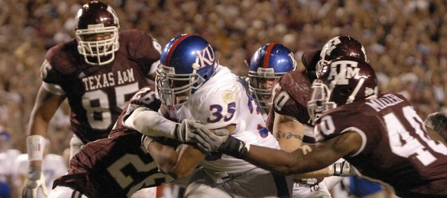 former Kansas running back Brandon McAnderson (35) busts through the Texas A&M defense for a touchdown in this Oct. 27, 2007 file photo from College Station, Texas. After a short stint with the Rams as a free agent before getting cut, McAnderson worked out with Oakland, but is still looking for work in professional football.