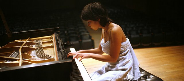 Constance Lin Kaita, 13, of Manalapan, N.J., was one of 16 finalists to compete in a piano competition Sunday during the International Institute for Young Musicians Summer Music Academy at Murphy Hall on the Kansas University campus.
