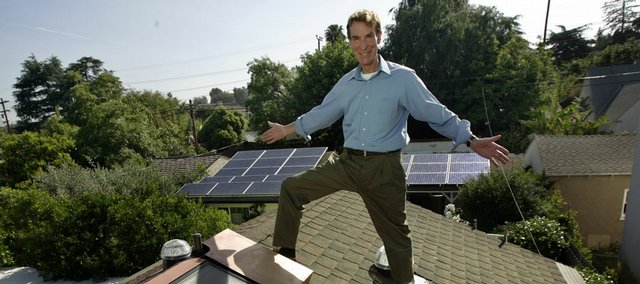 "Bill Nye poses on his home's roof with a solar water heating panel, foreground, and solar electric panels, background, in the Studio City district of Los Angeles. Nye, the host of the educational series ""Bill Nye, The Science Guy,"" and his neighbor actor Ed Begley are locked in a friendly but serious eco-battle of keeping up with each other."