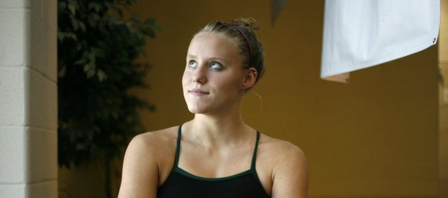 Lawrence's Emma Reaney, 15, who competed at the Wave the Wheat swim meet Friday, July 11, 2008, also competed at the 200-meter individual medley US Olympic Time Trials in Omaha, Neb. She tied for 73 out of 110 competitors. Here she's pictured at the Lawrence Indoor Aquatic Center on Friday.