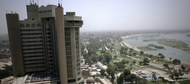 A high-rise building, a newly opened park and the Tigris River are seen Sunday in central Baghdad. The Iraqi capital is becoming more stable as violence is dropping.