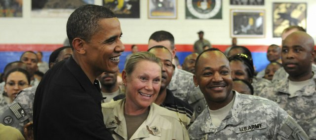 Presidential candidate Sen. Barack Obama, D-Ill., shakes hands with service members Friday at Camp Arifjan, Kuwait, at a stop ahead of his visit to Afghanistan.