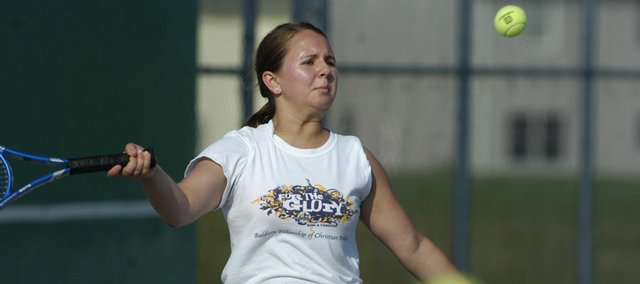 Baldwin City senior Brianna Krysztof takes aim with her tennis swing Thursday, July 17, 2008 during a Lawrence Tennis Association Junior League practice at Free State High School.