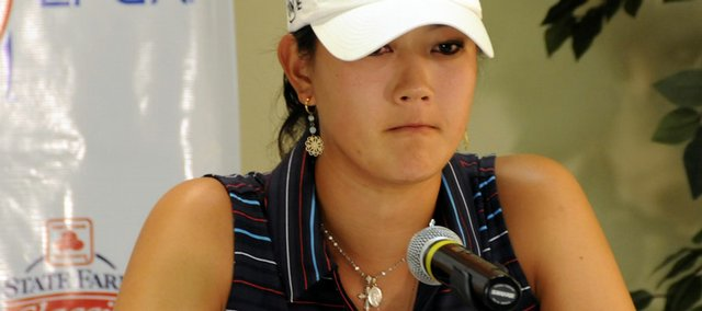 Michelle Wie speaks to reporters after learning she had been disqualified from the LPGA State Farm Golf Classic on Saturday in Springfield, Ill.
