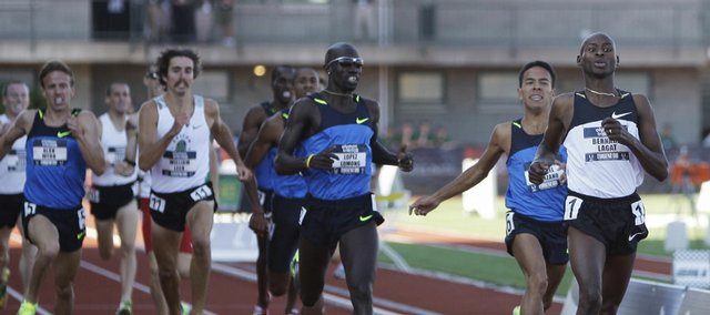In this July 6 file photo, Bernard Lagat, right, wins the men's 1,500-meter final at the U.S. Olympic Track and Field Trials in Eugene, Ore. Just to the left of Lagat is Leo Manzano, and to the left of Manzano is Lopez Lomong. All three are foreign-born; Lagat in Kenya, Manzano in Mexico and Lomong in Sudan, and all three will compete at the Beijing Olympics as members of the United States team.