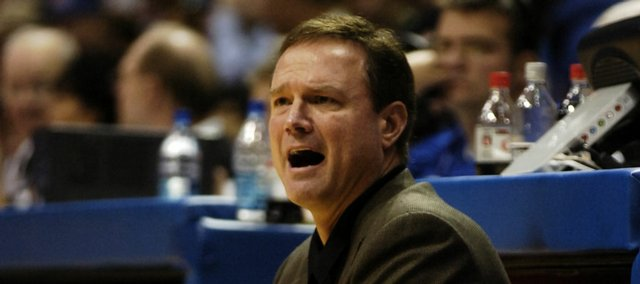 Kansas coach Bill Self looks to an official in this Nov. 6, 2007 file photo in Allen Fieldhouse. Self has spent a considerable amount of his time on the road during the July recruiting period.