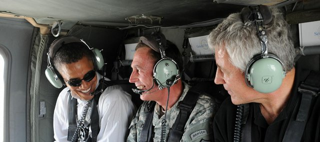 Presidential candidate Barack Obama, from left, Gen. David Petraeus, center, and U.S. Sen. Chuck Hagel, R-Neb, ride in a helicopter Monday in Baghdad.