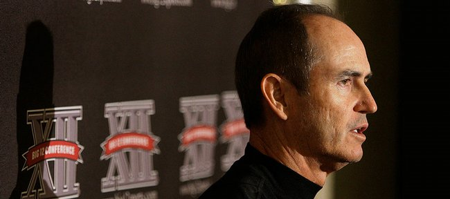 Baylor football coach Art Briles speaks to reporters during the Big 12 Football Media Days on Wednesday in Kansas City, Mo. Briles enters a situation much like Kansas football coach Mark Mangino in 2002, when the Jayhawks&#39; coach took over a struggling 3-8 program.