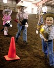 Stick-horse riders, from left, Mary Kate, 4, and Will Shultz, 6, both of Lawrence, and Sean Wunder, 3, of Berryton, trot around the arena during a children's event at the Douglas County Fair's open horse show Sunday at the fairgrounds.