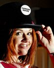 Lisa Covington, a breast cancer survivor, sports a top hat Saturday at Lawrence Memorial Hospital, location of the Betsy Beisecker Memorial Tea. The 10th annual event was free, although tickets were required.