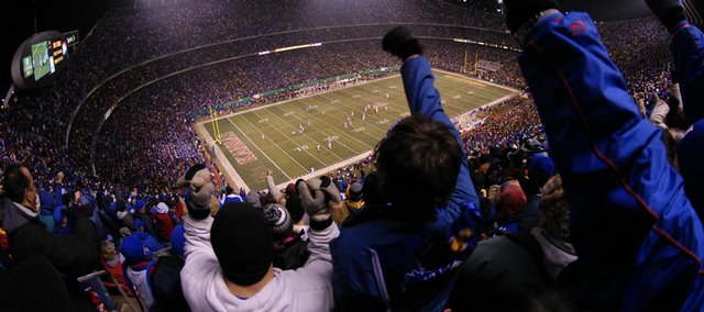 Fans cheer during Kansas University's game against Missouri on Nov. 24, 2007, at Arrowhead Stadium in Kansas City, Mo. Kansas and Missouri certainly did their part to close the gap in the Big 12, as the Jayhawks and Tigers played in the most high-profile conference football game of 2007.