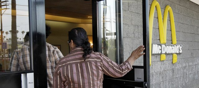 Customers enter a McDonald's restaurant in Los Angeles on Monday. The City Council is putting South Los Angeles on a diet, voting unanimously Tuesday to place a moratorium on new fast food restaurants in an impoverished area of the city.