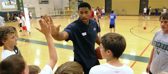 "Wayne Simien high-fives his campers after running through the importance of working hard off the ball on defense. Simien ran the first session of his ""Called to Greatness"" basketball camp on Tuesday at Free State High."
