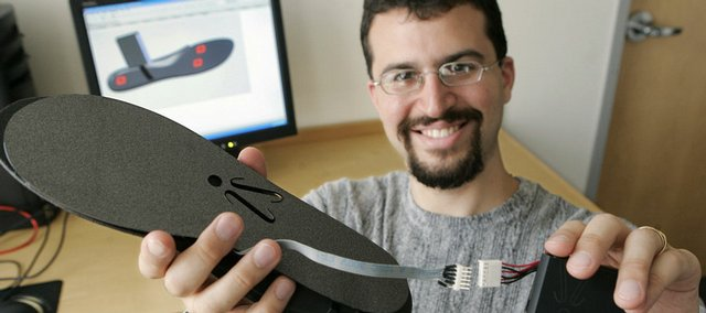 "Erez Lieberman displays an ""iShoe"" insole in Cambridge, Mass. He developed the insole, which contains sensors that can detect a wearer's balance, while working as an intern at NASA. He says the device could help elderly people avoid catastrophic falls."