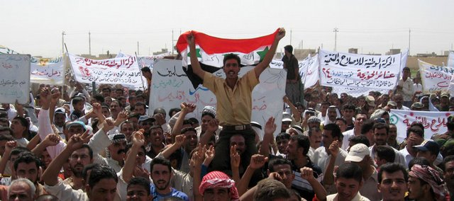 People attend a protest Saturday in the town of Hawija, Iraq. More than 1,000 Sunni Arabs and Turkomen staged a demonstration to protest calls by Kurds to annex the oil-rich city of Kirkuk to their autonomous region.