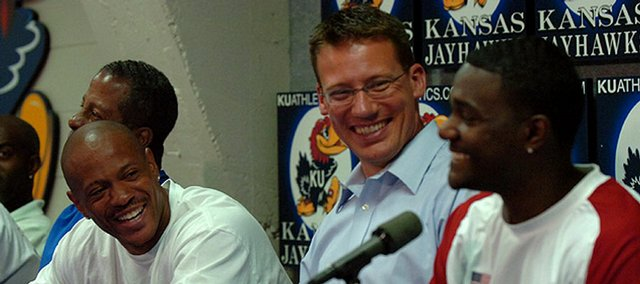 Former Kansas Relays meet director Tim Weaver, center, laughs with sprinters Maurice Greene, left, and Justin Gatlin during a news conference at Memorial Stadium in this April 2006 file photo. Weaver is going with other U.S. Track and Field officials to the Olympics in Beijing, China.