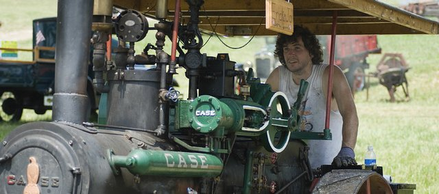 Matt Petty, Meriden, keeps his eyes on the pressure gauge on his half-scale 65 Case steam engine named Ericka Jo. Petty joined several other steam engine and tractor enthusiasts Saturday in McLouth for the 51st annual Threshing Bee.