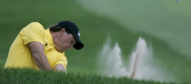 Phil Mickelson hits out of a sand trap during the third round of the Bridgestone Invitational. Mickelson fired a 68 on Saturday in Akron, Ohio.