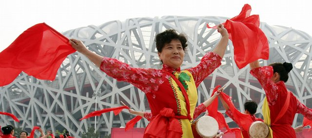 Performers dance during a 100 Days Countdown celebration to the Beijing Summer Olympics outside the National Stadium, also known as the Bird's Nest. China's hopes that the Olympics would be a pivotal moment in national glory and global acceptance have been hammered as unforeseen events collided with its grand goals.