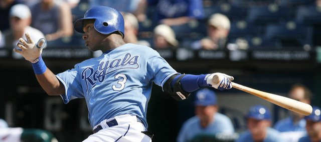 Kansas City's Esteban German hits a two-run triple in the fifth inning against the Chicago White Sox on Saturday in Kansas City, Mo. The Royals won, 9-7.