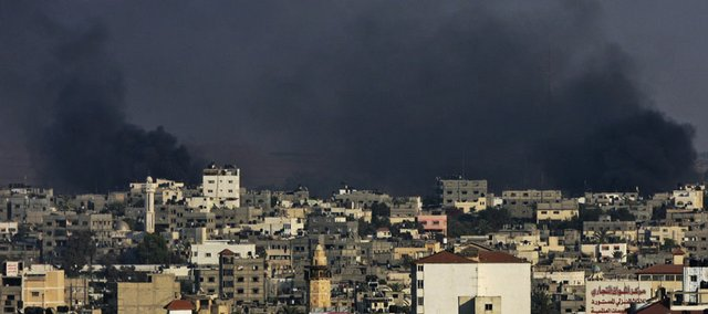 Smoke rises over buildings during a crackdown by Hamas security forces on the Fatah-linked Hilles clan Saturday in Gaza City. Hamas forces on Saturday battled Fatah gunmen in a crowded Gaza City neighborhood, leaving at least nine dead and more than 80 wounded.
