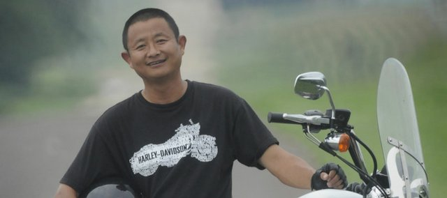 A Harley-Davidson in a Kansas landscape is quite a different scene for Chinese native and Lawrence resident Ray Chao. Chao grew up in China during the Cultural Revolution.