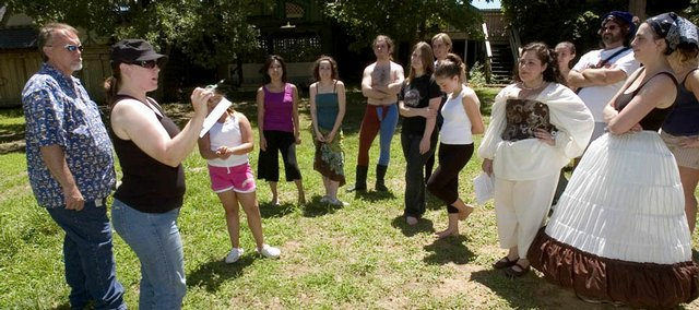 After running through a scene, stage manager Rebecca Stamberger, second from left, goes over lines and directions that need correction with performers for this year's Renaissance Festival.