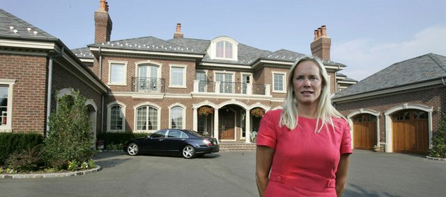 Real estate agent Margaret Trautmann shows a home she's selling in Muttontown, N.Y. The economic slump is cutting into sales of luxury homes, goods and services, and when the nation's wealthy crimp their spending, it can have a ripple effect across the economy.
