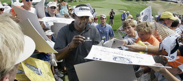 Vijah Singh signs autographs during his practice round for the PGA Championship at Oakland Hills on Wednesday in Bloomfield Township, Mich.