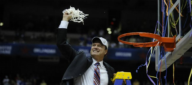 Kansas basketball coach Bill Self celebrates after the Jayhawks defeated Memphis to win the national championship in this April 7 file photograph. Self has signed a new 10-year contract with KU.