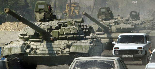 A column of Russian tanks rolls near the town of Dzhava on Sunday in the separatist Georgian province of South Ossetia. Georgia called a cease-fire Sunday and said it was pulling its embattled troops out of the disputed province of South Ossetia, submitting to Russia's superior firepower, but Moscow disputed the pullout claim.