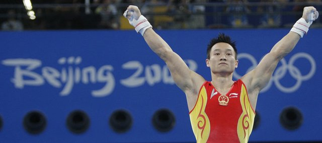 China's Yang Wei gestures after a performance during the men's individual all-around competition. Yang won the gold early today in Beijing.