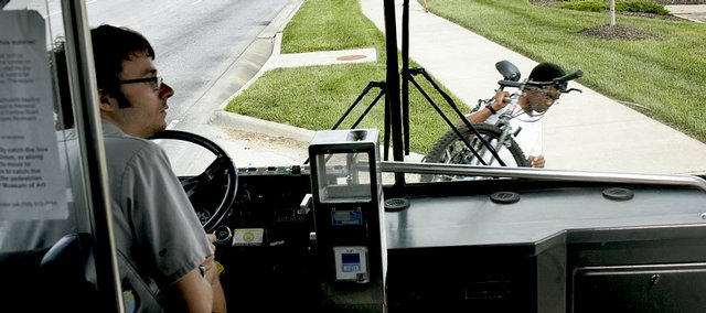 Lawrence Transit System driver Sam Schlageck, left, lets passengers off his bus Wednesday, Aug. 13, 2008 during a stop in south Lawrence.
