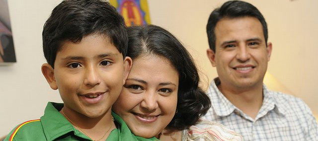 Susana Mariscal del Villar, her son, Joaquin, and her husband, Daniel Dorado, are pictured at their Lawrence residence. Susana is a Kansas University Fulbright scholar from Bolivia. KU Fulbright Association members played an integral role in helping her family settle in the United States.